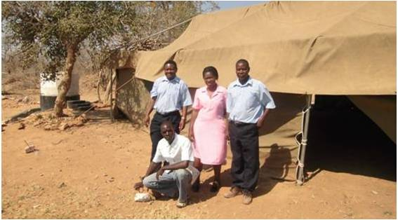 Our North Star Alliance team from Chirundi South. in front of the border Ebola treatment / isolation tent.
