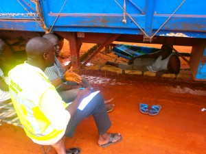 North Star Alliance project manager, Samba Touray, interviewing truck drivers in West Africa.