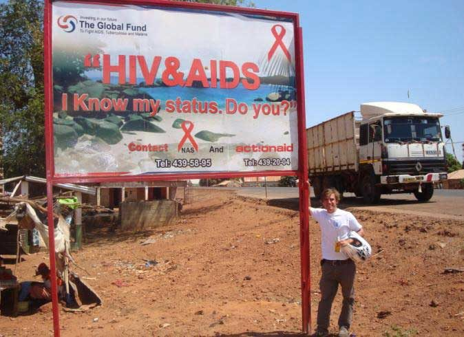 Phillippe Duterloo at an HIV/AIDS sign in The Gambia